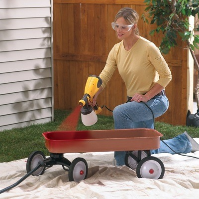 Woman using Wagner 0417005 Control Spray HVLP Sprayer.